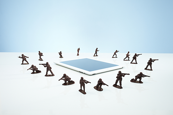 Toy Soldiers In A firewall Around Tablet Photograph by Richard Drury