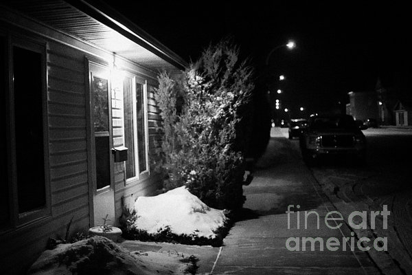 Traditional Photograph - Traditional House With Porch Light Outside The Door And Snow Cleared Pavements At Night Delisle Sask by Joe Fox
