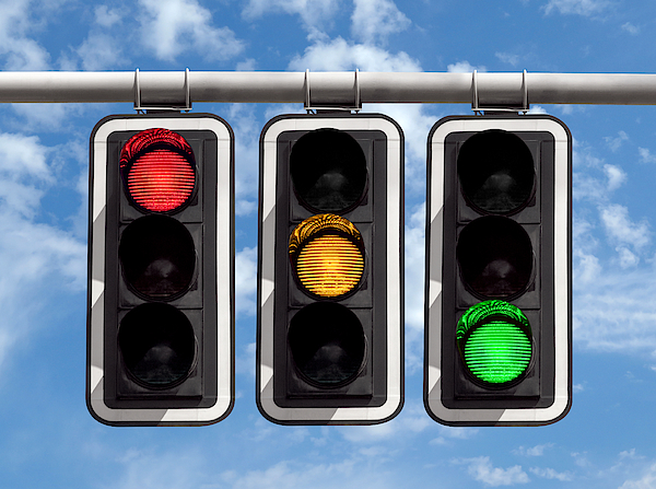 Traffic Lights - Red Yellow Green Against Sky Photograph by Venakr