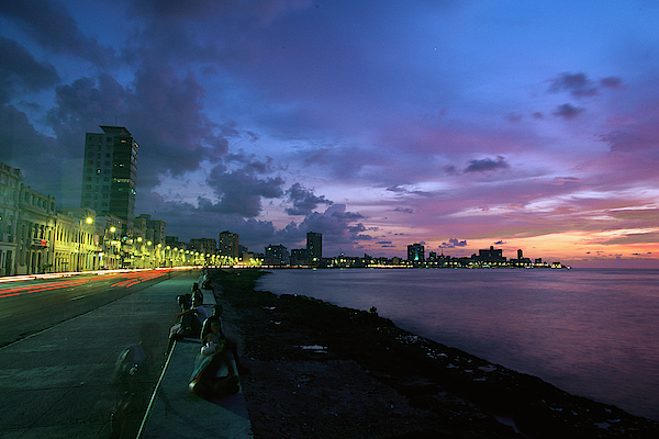 Atlantic Islands Photograph - Twilight View Of Young Cubans Sitting by Steve Winter