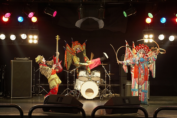 Two Actors And An Actress Dressed As Traditional Beijing Opera Characters Play Rock And Roll Together On Stage. Photograph by Blue Jean Images
