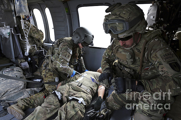 Afghanistan Photograph - U.s. Army Flight Medics Aid A Simulated by Stocktrek Images