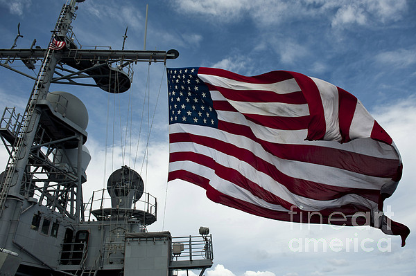 Us Navy Photograph - Uss Cowpens Flies A Large American Flag by Stocktrek Images