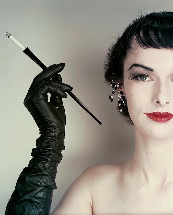Victoria Von Hagen Holding A Cigarette Holder Photograph by Erwin Blumenfeld