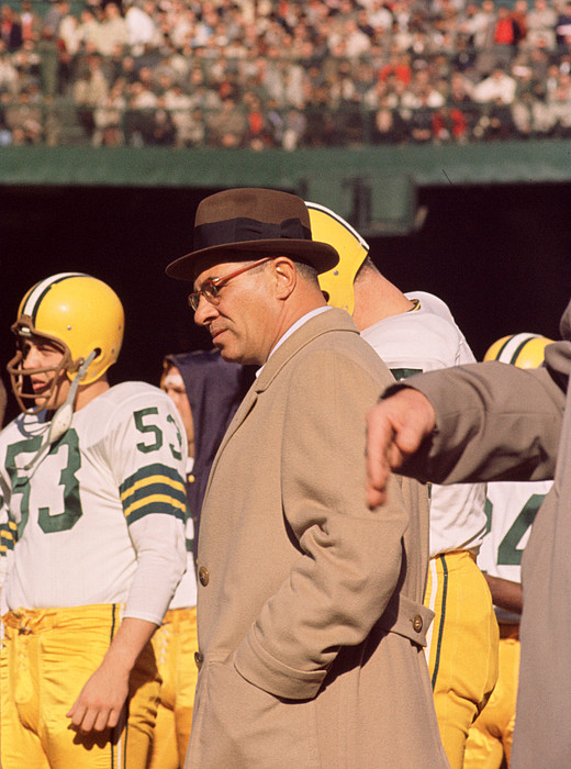 Marvin Newman Photograph - Vince Lombardi In Trench Coat by Retro Images Archive