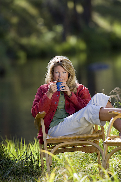 Woman Drinking Coffee Photograph by Comstock Images
