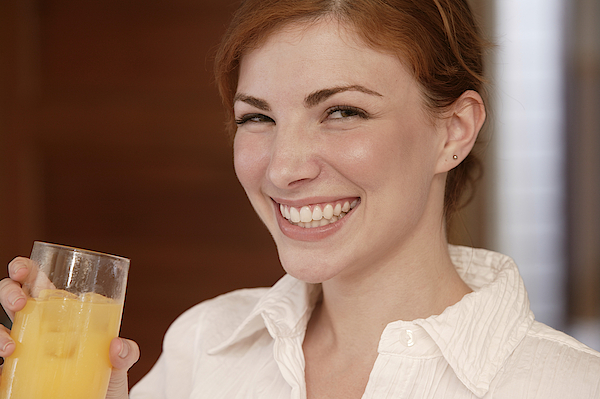 Woman Drinking Juice Photograph by Comstock Images