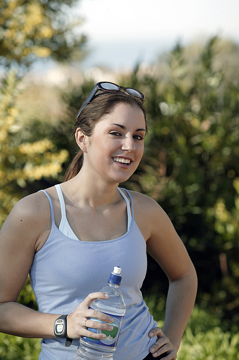 Woman Drinking Water During Exercise Photograph by Comstock Images