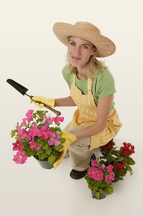 Woman Gardening Photograph by Comstock Images