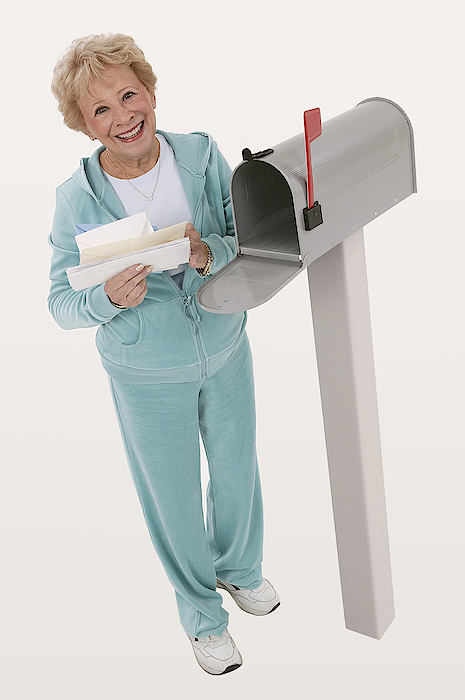 Woman Getting Mail Photograph by Comstock Images