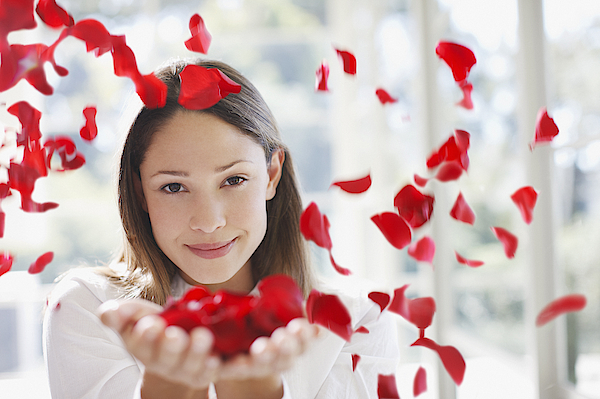Woman Holding Handful Of Flower Petals Photograph by Tom Merton