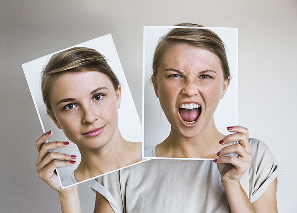 Woman Holding Happy And Angry Portraits Photograph by Dimitri Otis