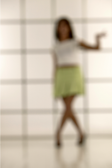 Woman In Skirt Blurred Photograph by Comstock Images