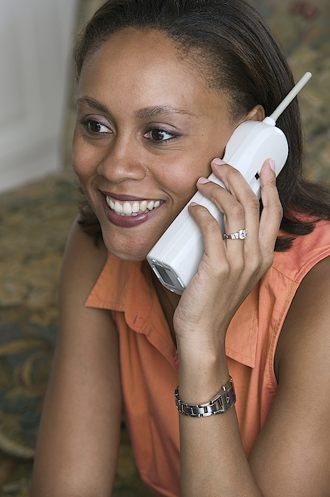 Woman On Cordless Telephone Photograph by Comstock