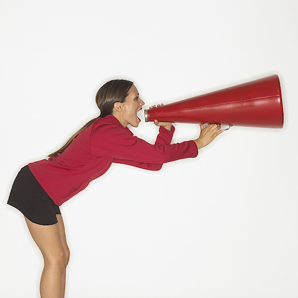 Woman Screaming Into Bullhorn Photograph by Brand X Pictures