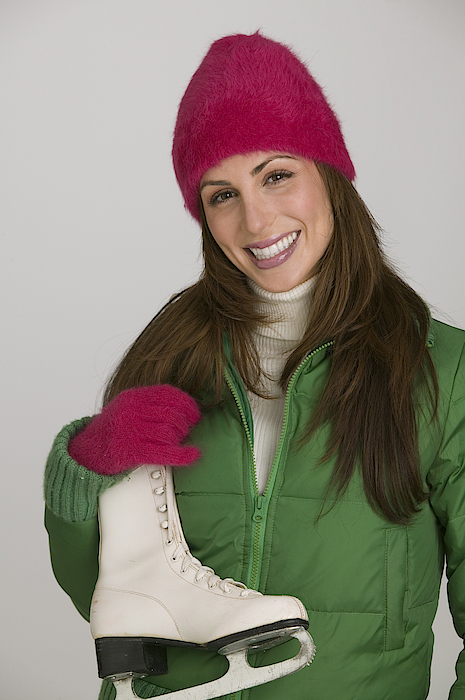 Woman With An Ice Skate Photograph by Comstock Images