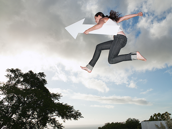 Woman With Blank Arrow Leaping Outdoors Photograph by Robert Daly