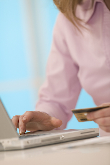 Woman With Laptop And Credit Card Photograph by Comstock Images