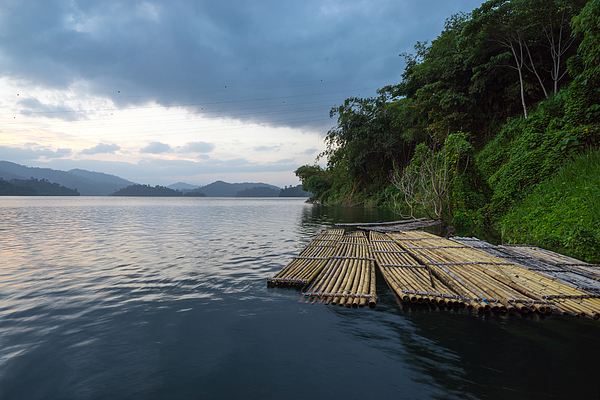 Wooden Rafts Moored On Lake By Trees Against Cloudy Sky Photograph by Shaifulzamri Masri / EyeEm