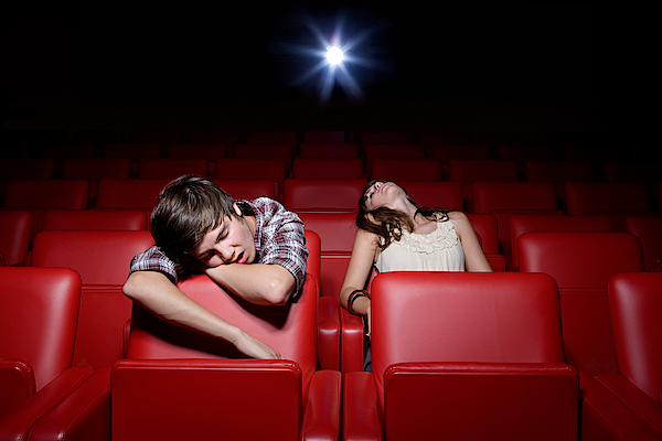 Young Couple Asleep In The Movie Theater Photograph by Image Source
