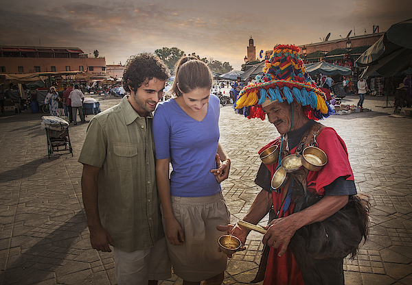 Young Couple Chatting With Market Trader, Jemaa El-fnaa Square, Marrakesh, Morocco Photograph by Lost Horizon Images