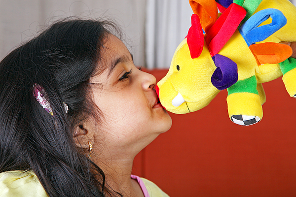 Young Girl Kissing A Soft Toy Photograph by Visage