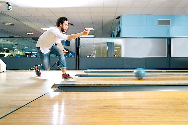Young Man Bowling Photograph by RoBeDeRo