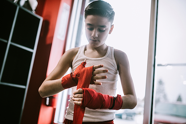 Young Man In Kickboxing Training Center Photograph by RyanJLane