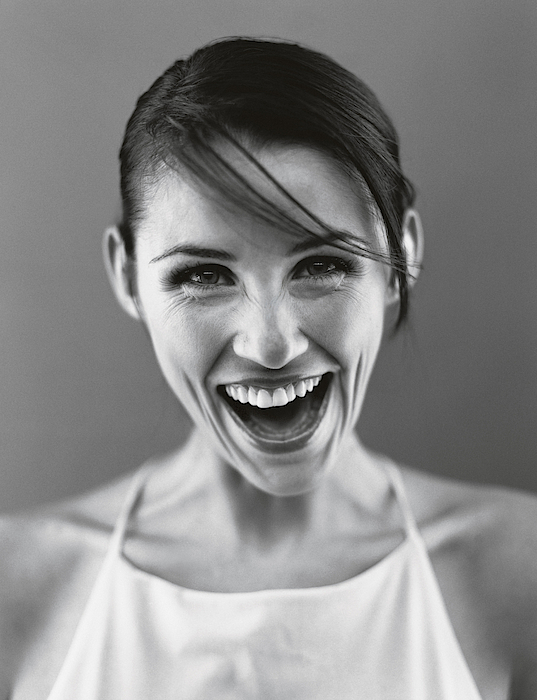 Young Woman Laughing, Headshot Indoors Photograph by Elke Hesser