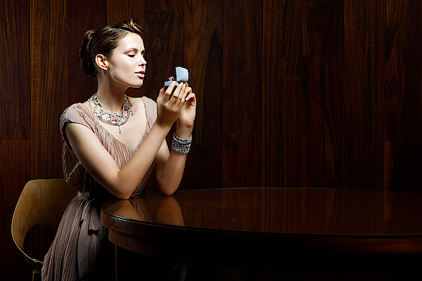 Young Woman Looking At Engagement Ring In Box Photograph by Image Source
