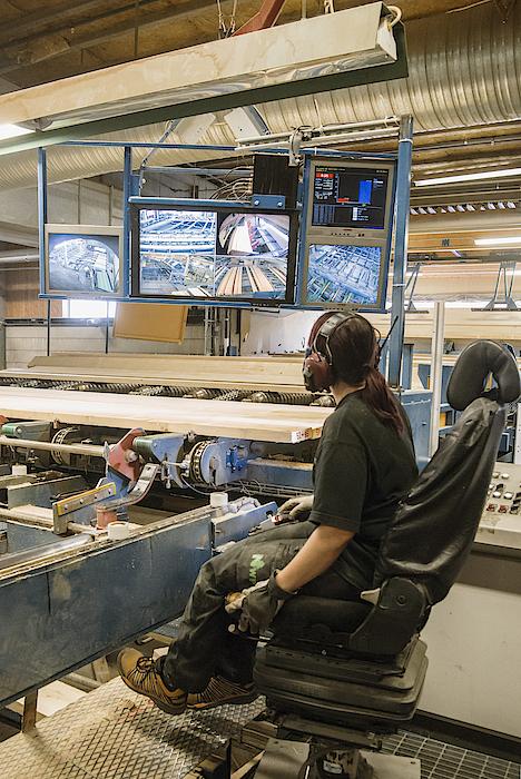 Young Woman Using Control Panel While Monitoring Computer Screens At Sawmill Photograph by Hakan Jansson