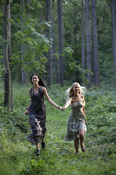 Young Women Running Through Forest Photograph by Asia Images