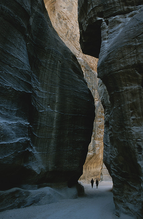 Asia Photograph - Hikers In The Siq Canyon Leading by Gordon Wiltsie