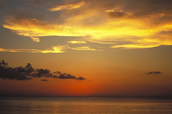 Calm Photograph - Sunset On Horizon Of Caribbean Sky by James Forte