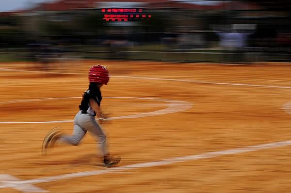 Outdoors Photograph - A Boy Runs During A Baseball Game by Raul Touzon