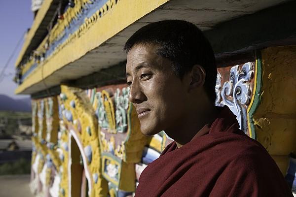 Qinghai Province Photograph - A Buddhist Monk Near The Edge by David Evans