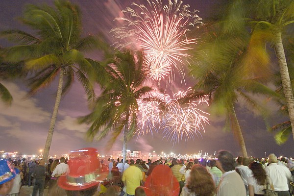 Night Photograph - A Crowd Gathered On New Years Eve by Mike Theiss