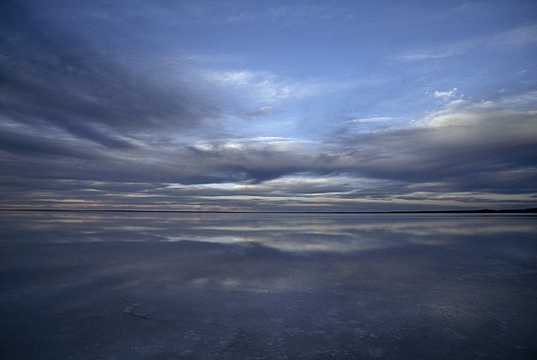 Outdoors Photograph - A Fading Sunset Reflects Off The Still by Jason Edwards