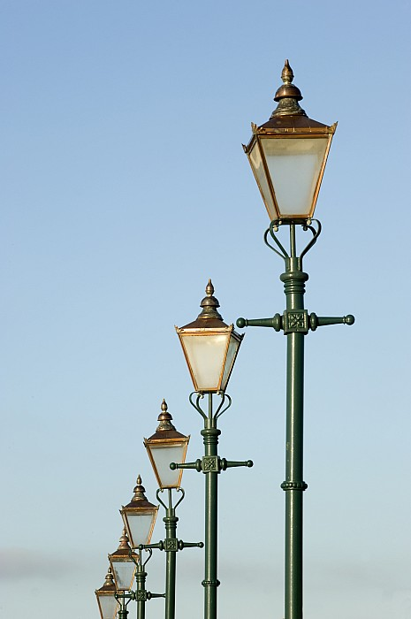 Outside Photograph - A Group Of Old Gas Street Lamps by Bill Hatcher