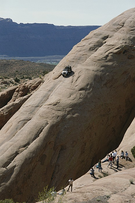 Rock Formations Photograph - A Jeep Drives Down A Slick Rock by James P. Blair