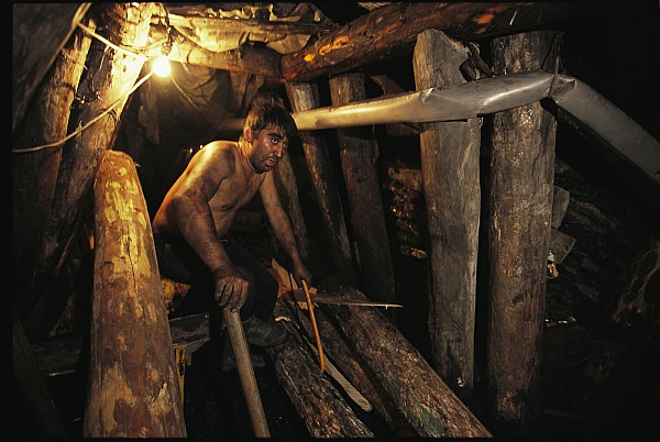 Laborers Photograph - A Miner Works His Way Through A Jumble by Randy Olson
