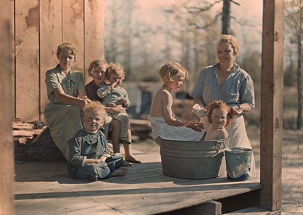 Outdoors Photograph - A Mother Bathes Her Children by J Baylor Roberts