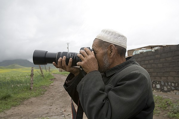 Qinghai Province Photograph - A Muslim Rural Resident Looks by David Evans