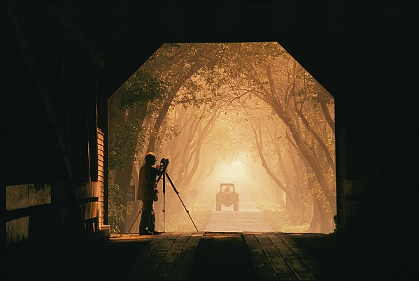 Rural Ways Of Life Photograph - A Photographer Sets Up His Camera by Richard Nowitz