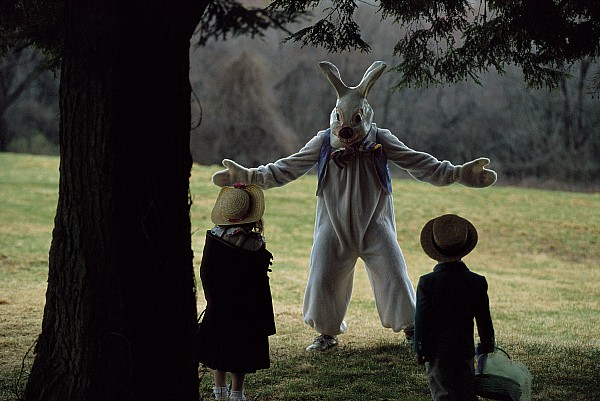 Outdoors Photograph - A Rabbit Meets Two Children During An by Joel Sartore