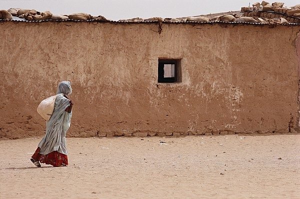 Africa Photograph - A Refugee From Western Sahara Leaves by Steve Raymer