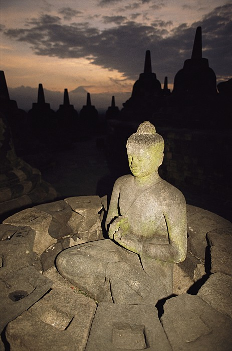 Architecture And Art Photograph - A Statue Of Buddha,  Borobudur, Java by Paul Chesley