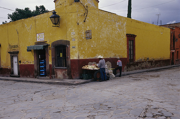 North America Photograph - A Vendor Selling Food On A Street by Gina Martin