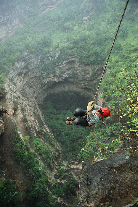 Outdoors Photograph - A Woman Climbs Out Of Tawi Attair by Stephen Alvarez