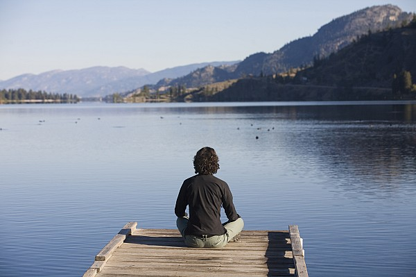 Okanagan Valley Photograph - A Woman Enjoys Yoga And Relaxation by Taylor S. Kennedy
